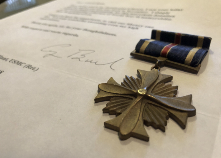 The+Distinguished+Flying+Cross+awarded+to+Lieutenant+Colonel+Al+Hunt+%28grandfather+of+freshman+Cole+Hunt%29+and+letter+signed+by+George+H.W.+Bush