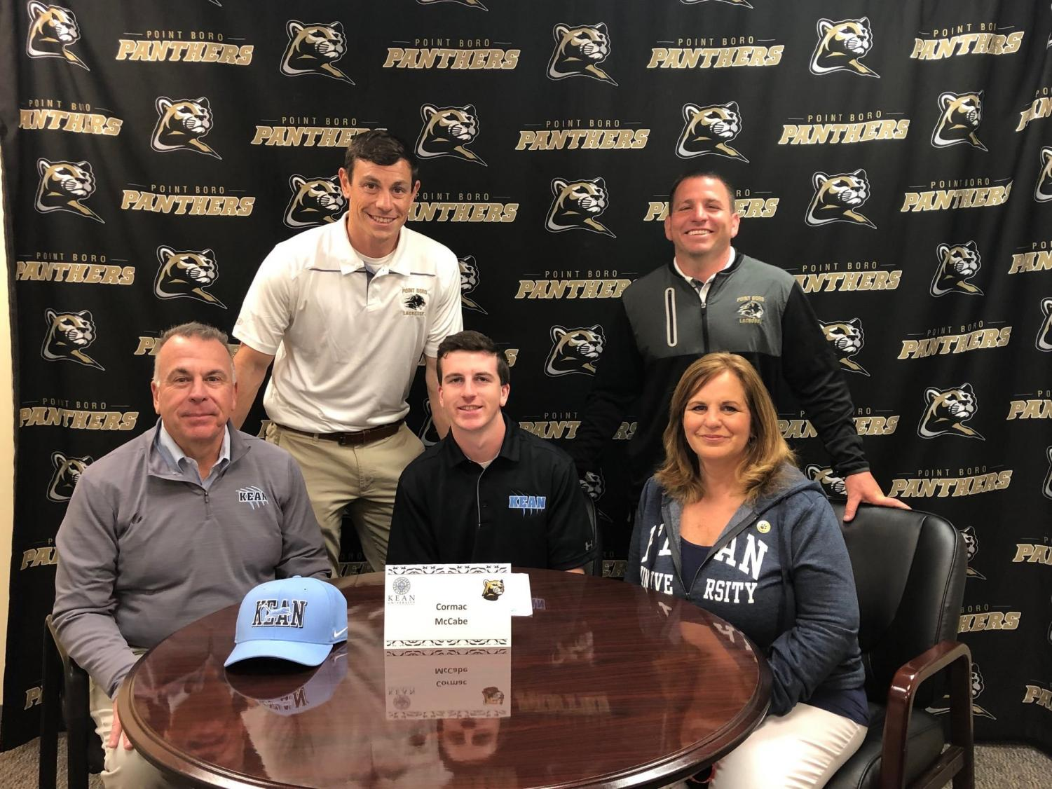 Senior Cormac McCabe signs his letter of intent to play lacrosse at Kean University in the fall of 2019.