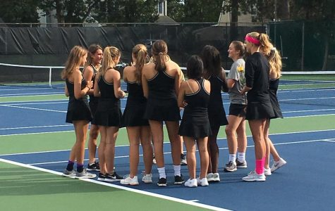 Team huddle before the match.