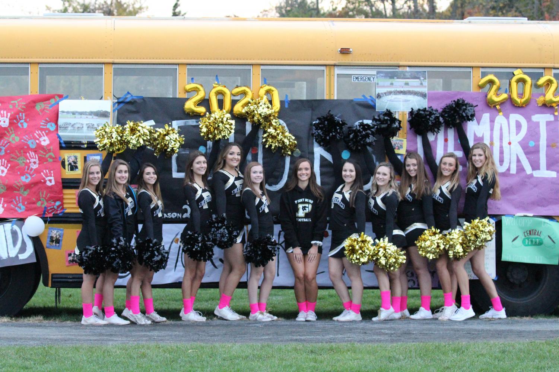 Senior cheerleaders kick off the start of the Homecoming football game.