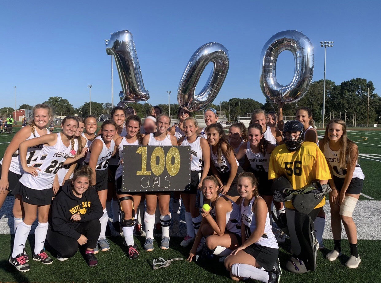 Senior Jordan Carr (center) after scoring her 100th career goal.