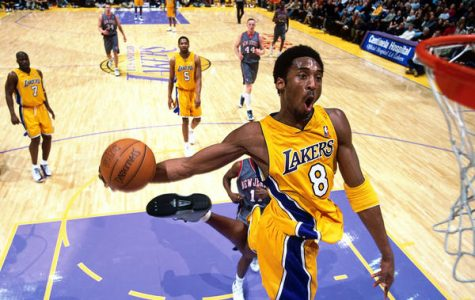Kobe displaying one of his signature dunk moves.