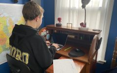Sophomore, Evan Melito, does his online school work from his room.